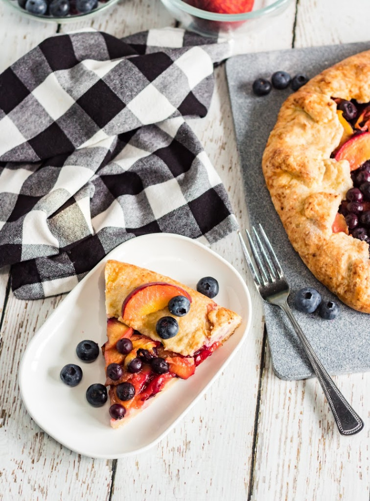 peach blueberry galette on a serving plate