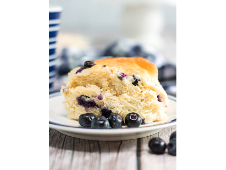 blueberry biscuits with blueberries on plate