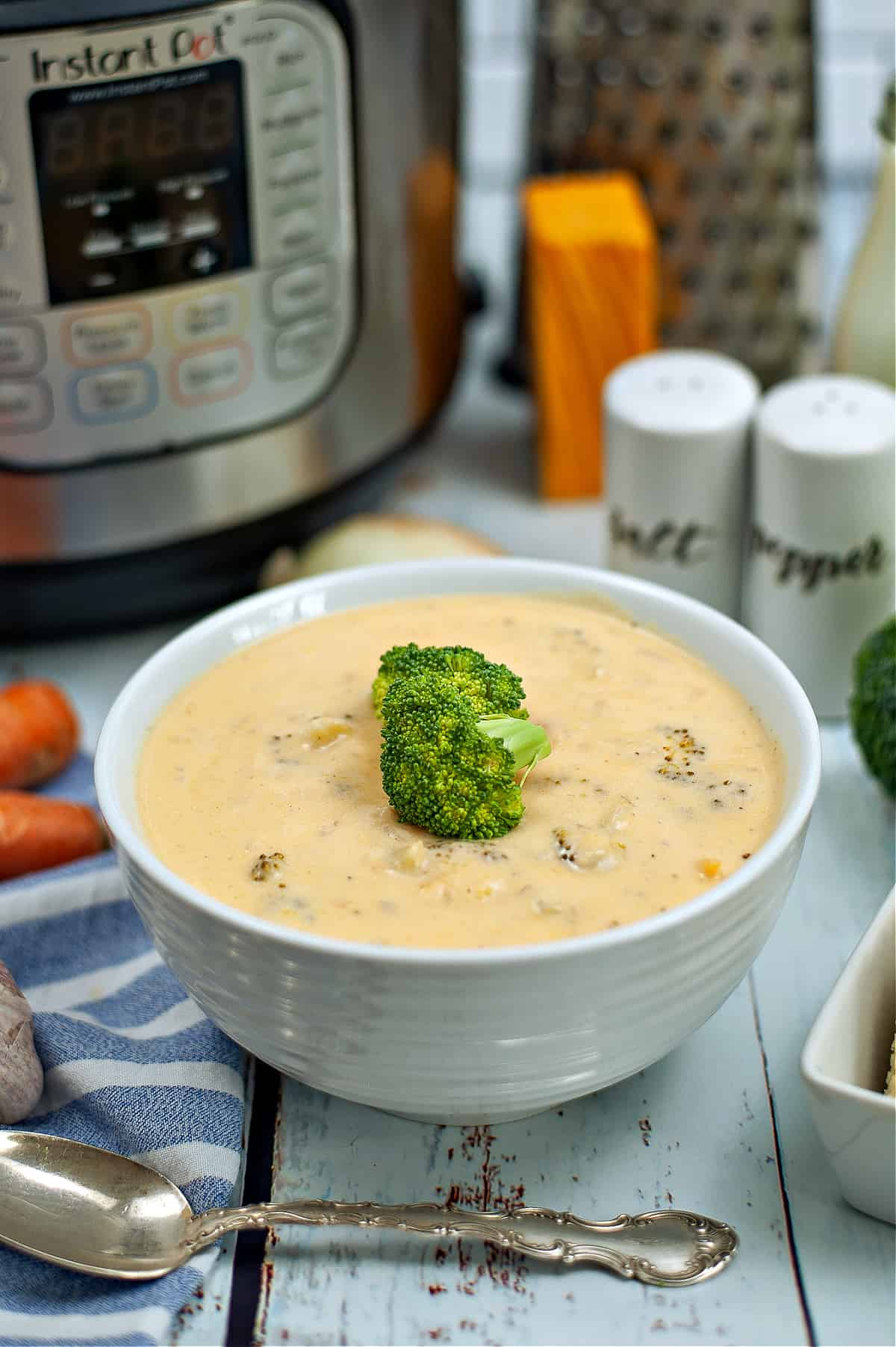 instant pot and bowl of broccoli cheddar soup