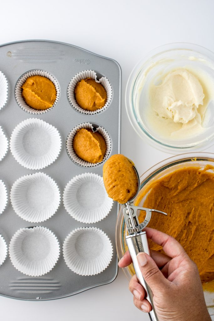 adding the muffin batter to the muffin cups