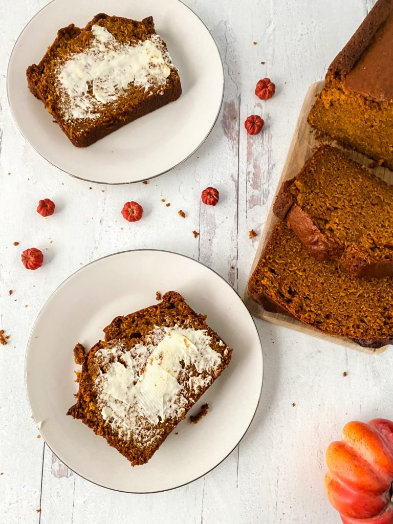 copycat Starbucks Pumpkin Bread on a plate with cream cheese